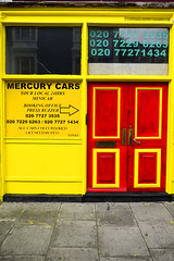Need a cab? (David Allen's Photostream) Tags: red yellow contrast bright cab taxi shopfront garish davidallen contrasting
