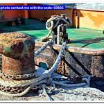Boat moorings oxidized in a fishing port thumbnail