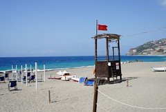 Red flag (aclay) Tags: red sea summer italy beach nature water sicily summertime