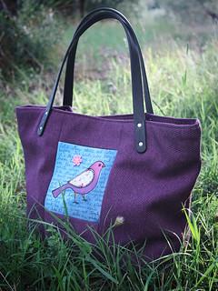 bird in purple bag