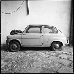 (Side By Side With a Fiat 600) (Robbie McIntosh) Tags: blackandwhite bw 120 6x6 film monochrome car mediumformat square classiccar fiat 10 hasselblad negative ilfordhp5 600 hp5 ilford 400iso dyi fiat600 pellicola hasselblad500cm selfdevelopment mittelformat moyenformat filmisnotdead acufine medioformato homedevelopment carlzeissdistagon50mmf4ct