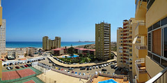 a room with a view (maximorgana) Tags: park blue sea sky lighthouse building tower water car fence court horizon swimmingpool tennis carpark lamanga cabodepalos marmayor