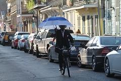 NEW ORLEANS - SUNDAY DRIVER (Punxsutawneyphil) Tags: street shadow usa man cars senior bike bicycle america umbrella us louisiana unitedstates south neworleans sunday streetlife sunshade american parasol biking northamerica mann autos amerika schatten shady sonntag fahrrad deepsouth regenschirm schirm sonnenschirm schattig fahrradfahren vereinigtestaaten nordamerika strase