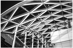 Something different, for a change... (aistora) Tags: uk roof light england sky blackandwhite bw white abstract building london art geometric glass monochrome up mobile architecture contrast mall shopping phonecam grid mono design 3d triangle phone graphic britain designer drawing geometry space sony escalator arcade skylight picture entrance cellphone style structure minimal explore architect smartphone frame translucent framework elegant westfield z1 postprocess android lattice app shepherdsbush edit upward stylish graphical triangular geodetic spacial gridwork semiabstract maistora procss quasiabstract xperia picsay snapseed explored20aug14