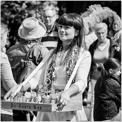 Chocolate lollipops... (John Riper) Tags: street bw white black netherlands monochrome lady john square photography mono zwartwit chocolate lolly lollies lollipops schiedam vierkant straatfotografie debontekoe riper johnriper zwvk dvdrm