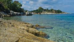 Corfu Rocks (stumpyheaton) Tags: blue trees sea sky seascape beach water clouds island nikon rocks day greece corfu kassiopi d5100