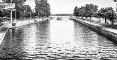 Ste-Anne de Bellevue canal just out of the locks facing east  DSC_6185 Canal  Ste-Anne de Bellevue face  l'est (Nicole Nicky) Tags: steannedebellevue quebec montreal blackandwhite monochrome noiretblanc outdoor dehors water eau canal watercourse nikon canada summer t boats bateaux