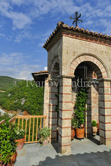 In a mountain monastery (Ivanov Andrey) Tags: monastery building cross christianity orthodoxy religion prayer mountain slope sky cloud perspective history architecture flower flowerpot plant green tree bush fence balcony sun noon shadow horizon journey walk greece