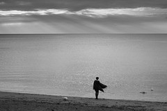 Pebble Skimming (evans.photo) Tags: sea aberystwyth people seaside water stones throwing beach sunlight evening