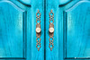 Stylish brass door handles on a cabinet or closet (Simeon Donov) Tags: access arched background blue brass cabinet carpentry centered closed closet closeup copyspace cupboard cyan decor design door doors double entry escutcheon fitting front furnishing furniture handles hardwood home interior knob mediterranean metal ornate panels pattern raised recessed retro round symmetry turquoise vintage vivid wood wooden woodwork