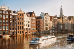 Golden hour (spiridono) Tags: amsterdam city view canal netherlands golden hour sun light water cityscape architecture europe boat