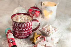 Christmas Cocoa (susans7777) Tags: christmas hot chocolate cocoa marshmallows cracker red white snow cinnamon sticks hearts lovehearts candle candy cane drink warm festive comfort snuggle cup