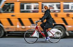 Beijing Cycling (glendamaree) Tags: panning cycling bicycle china orange nikon d750