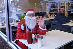 Santa has a refreshing coke between deliveries (helenoftheways) Tags: santaclaus fatherxmas red café beard ladywell london uk people sit sitting seated
