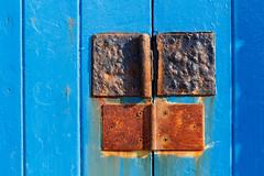 Story in rust - EXPLORED (paul indigo) Tags: door hinge blue rust closed graphic paulindigo