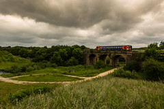 An unidentified Single Car DMU passes over Shirebrook Viaduct on the Robin Hood Line on 19-06-2014 with a Worksop to Nottingham working (kevaruka) Tags: summer cloud june clouds digital canon eos flickr derbyshire scenic wideangle viaduct fullframe frontpage hops 2014 electrification cloudyday dmu networkrail 1635l highmarnham shirebrook 5dmk3 5d3 5diii