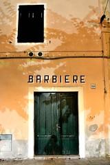 Barbeccapelli, ma non ora (Il cantore) Tags: door shadow orange muro verde green window sign shop wall closed ombra finestra barbershop porta insegna chiuso arancione barbiere bottega 15challengeswinner