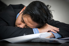 Tired overworked businessman sleeps (anekphoto) Tags: man male businessman work notebook table asian thailand glasses office asia break technology desk sleep background report hard young bored boring professional business suit sleepy lazy tired thai workplace data rest worker resting asleep manager stress executive job fatigue employee exhausted overload paperwork career bore exhausting occupation overtime overworked overwork