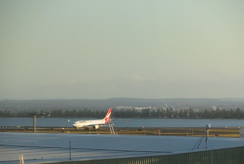 Having just touched down, this Qantas flight turns off the runway to head to the terminal.