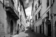 Via Moncini (YaYapas) Tags: street city italien blackandwhite bw italy monochrome tuscany stadt schwarzweiss 16mm toskana massamarittima strase d7100 tokina1116