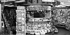 Newspaper Stall (Pexpix) Tags: madrid blackandwhite bw film monochrome spain scanner iso400 ilfordhp5 es hpg4050 leica28mmsummicronmf2asph id111323c digitizedfilmnegative leicampsilver leica28mmsummicronmf2asphleica28mmsummicronmf2asphleica28mmsummicronmf2asph