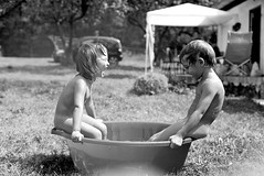 Aaaaaaaa! (Misko78) Tags: blackandwhite bw rain kids 35mm bath exposure play free nikkor agfa nikonf2 enfant libre 25asa plustek agfapan25 nikkor50mm14ai 7500i