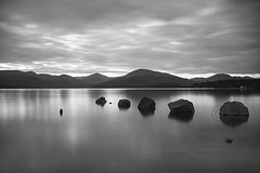 Rocks Water Mountains and Sky - Simple Beauty of Scottish Nature Scene - Black and White (Magdalen Green Photography) Tags: rocks water mountains sky longexposure loch scottishbeauty landscape pretty zen blackandwhite simplebeauty scottishnaturescene scottishlandscape magdalengreenphotography lochlomond
