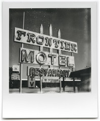 route 66 / frontier motel. truxton, az. 2015. (eyetwist) Tags: eyetwistkevinballuff eyetwist instant impossible route66 arizona polaroid sx70 project impossibleproject bw beta 600 testfilm polaroidsx70 impossiblebwgen20beta generation20 vintage modified landcamera emulsion film instantgratification analog analogue ishootfilm blackwhite monochrome goop streaks flaws spots black white truxton deserted type typography typographic numbers logo icon signgeeks signage frontier motel cafe rust rusty decay american typologies southwest usa route 66 restaurant neon tv vacancy novacancy closed sign frontiermotel roadsideamerica americana historic motherroad polaroidweek2016 roidweek mojavedesert desert