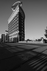 Western Auto Building, 2015 (Clay Percy) Tags: blackwhite bw buildings bridge brick urbanlandscape urban city railroad