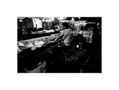 Stallholder in Lady Market, Hong Kong (Laurent Camus) Tags: hot hongkong lady market blackandwhite noiretblanc xpro1 hongkong2016voyageasieblackandwhitebw