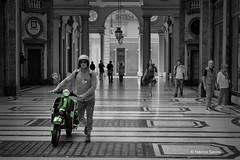 mitica vespa (sanino fabrizio) Tags: piaggio vespa ciclomotore scooter veicolo motore street photography persone gente centro storico bianco e nero bn torino piemonte italia quadrilatero canon 1855 550d