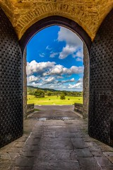 Through the Gatehouse (21mapple) Tags: chirk chirkcastle castle canon750d canon canoneos750d canoneos clouds blue sun sunny fields gatehouse turret medieval arch vault architecture nationaltrust national trust wales outdoors outside old imposing doors secure
