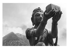 the offering (handheld-films) Tags: buddhism tiantanbuddha lantau ngongping devas sixperfections bronze statues mono blackandwhite hongkong religion religious offerings enlightenment travel fareast hills