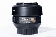 Lente Nikon (Cristhian Snchez 2016) Tags: lente lens nikon nikkor 35mm productor shop photography backgrpud white