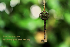 The key (eleni m) Tags: key sleutel old oud outdoor quote rope touwtje hedge heg bokeh dof green groen rust roest