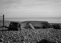 Boat in  a sea of Pebbles (davets26) Tags: eos7dmk2ef24105f4lisusm sidmouthbeach rowingboat abandodnboat pebbles devon