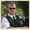 Piper (FotoFling Scotland) Tags: 2007 inverkeithinghighlandgames piper male bagpipe shades sunglasses