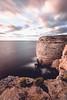 malta cliffs II (ikonoblast) Tags: malta cliff sundown sunset rock sky clouds sea water travel coast ocean seascape longexposure fujixe2 fujinon1024