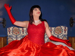 Red joy (Paula Satijn) Tags: red satin silk hot sexy lady girl gurl tgirl transvestite dress gown ballgown skirt shiny gloves lipstick fun bed glamour joy smile