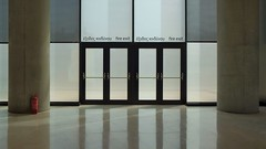 fire exit @ the acropolis museum (dan.boss) Tags: indoors minimal columns fireextinguisher doors athens acropolismuseum emergencyexit fireexit