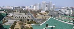 From Grand People's Study House (asenseof.wonder) Tags: park winter panorama tower architecture river outside outdoors store downtown day afternoon apartment kim propaganda balcony korea leaders avenue department northkorea pyongyang dprk ilsung   jongil