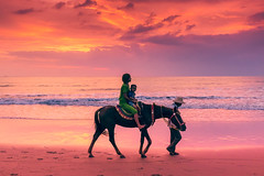 Picture of the Day #90 - Sometimes the Sun makes BOOM ( [Kristoffer]) Tags: ocean travel sunset horse woman sun beach water clouds reflections photography big sand asia fuji child sister burma ngc mother violet riding myanmar burmese relfection chaungtha x100s