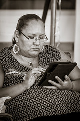 Booth Sitter (selmanphotos) Tags: family b portrait blackandwhite newmexico santafe booth streetphotography indianmarket nm ipad
