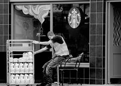 Pull (pootlepod) Tags: street blackandwhite reflection window monochrome pull photography milk cafe jacket starbucks delivery pulling struggle workman stphotographia