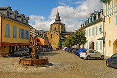 Place du Trey and bell tower of Saint-Savin (Pantchoa) Tags: fountain clouds french nikon cross belltower nubes nuages croix pyrnes clocher midipyrnes d90 hautespyrnes pyrenes pireneos 160850mmf3556 saintsanvin