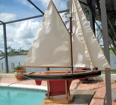gaff rigged pond yacht (oldsailro) Tags: park old boy sea summer people sun lake playing beach water pool girl sunshine youth sailboat race vintage children fun toy boat miniature wooden pond model waves sailing ship time yacht antique group boom mast kee