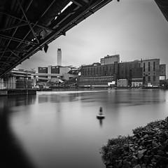 Hafen vom Kraftwerk Reuter (McGeiwa) Tags: hafen brcke boje gebude wolken steine ufer langzeitbelichtung