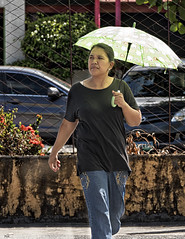 Lady with Umbrella. (Beegee49) Tags: filipina walking umbrella bacolod city philippines