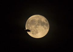 A helicopter flying by the rising Moon 16 Oct 2016 (Sculptor Lil) Tags: canon700d dslrsingleexposure london moonflyby astrophotography helicopter moon moonrise