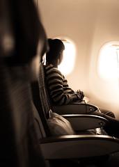 Await (relishedmonkey) Tags: nikon d5300 looking man person window flight light highlights sunshine rays inside seated seat hands one 35mm18g